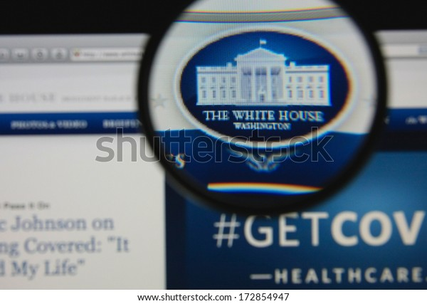 LISBON - JANUARY 23, 2014: Photo of the White House homepage on a monitor screen through a magnifying glass.