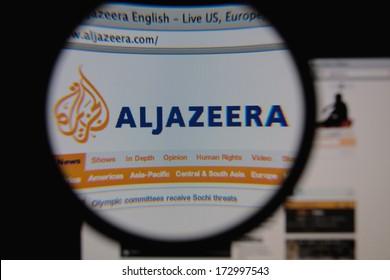 LISBON - JANUARY 25, 2014: Photo of Aljazeera homepage on a monitor screen through a magnifying glass.