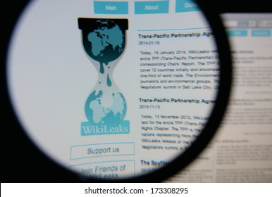 LISBON - JANUARY 27, 2014: Photo of Wikileaks homepage on a monitor screen through a magnifying glass.