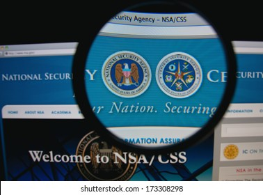LISBON - JANUARY 27, 2014: Photo of the NSA/CSS homepage on a monitor screen through a magnifying glass.