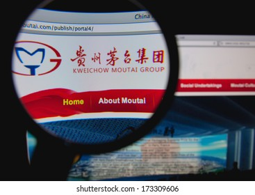 LISBON - JANUARY 27, 2014: Photo of Kweichow Moutai homepage on a monitor screen through a magnifying glass.