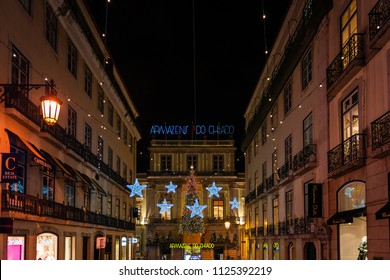 LISBON - JANUARY 3, 2018: Illuminated main entrance to the Grandes Armazens do Chiado, a famous shopping mall in the Barrio Alto district in Lisbon, Portugal.