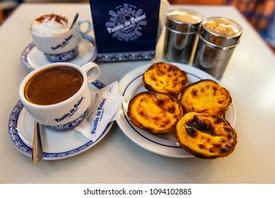 LISBON - JANUARY 4, 2018: Fresh Pasteis de Belem (typical Portuguese egg tarts) just backed in a local bakery in Lisbon.