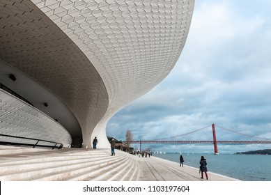 LISBON - JANUARY 4, 2018: Incidental people walking along the stairs and main entrance to the Museum of Art, Architecture and Technology (MAAT) in Lisbon by the River Tagus.