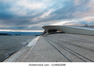 LISBON – JANUARY 4, 2018: Main entrance to the Museum of Art, Architecture and Technology (MAAT) in Lisbon by the River Tagus, with the Tejo Power Station in the background.