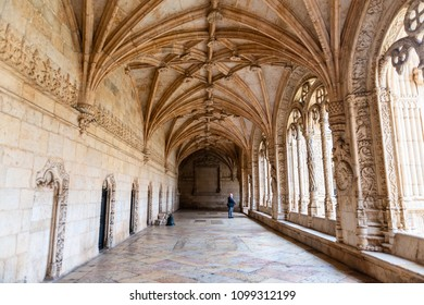 LISBON - JANUARY 4, 2018: Old man admiring the Late Gothic Manueline ornamentation in the cloister of Jeronimos Monastery (1469-1521) in Lisbon, Portugal.