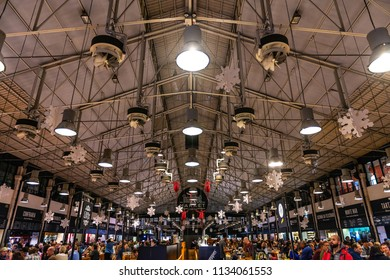LISBON - JANUARY 4, 2018: Wide-angle view of the modern Mercado da Ribeira Food Market in Lisbon, full of tourists and locals enjoying the local food scene.