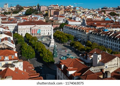 LISBON - JANUARY 6, 2018: Aerial view of the rooftops of the Baixa district in Lisbon on a sunny Winter morning, with the National Theatre in the background.