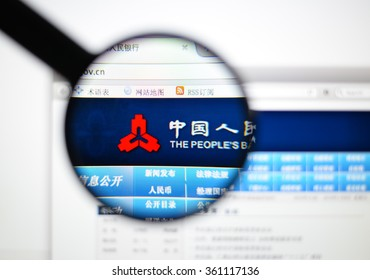 LISBON - JANUARY 7, 2016: Photo of Peoples Bank of China homepage on a monitor screen through a magnifying glass.