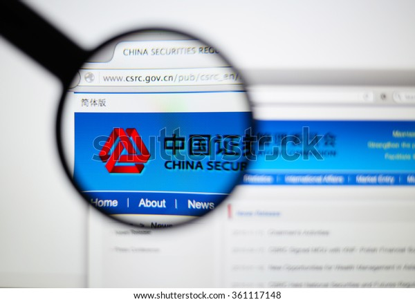 LISBON - JANUARY 7, 2016: Photo of CHINA SECURITIES REGULATORY COMMISSION homepage on a monitor screen through a magnifying glass.