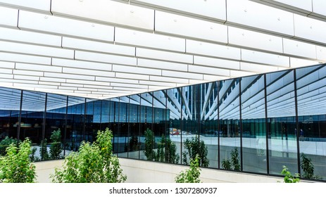 LISBON – July 25, 2018:  Long lines, mirrors and wide plans creating open spaces in modern architecture. Location: EDP Headquarters in Lisbon, Portugal