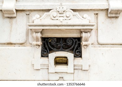 LISBON – July 5, 2018: Detail of the brass letterbox of the sumptuous neoclassical Vale Flor Palace built in early 20th century in Lisbon, Portugal Trans: Letters