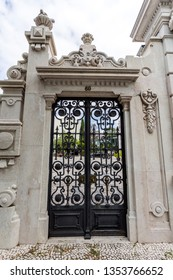 LISBON – July 5, 2018: Detail of the gate to the gardens of the sumptuous neoclassical Vale Flor Palace built in early 20th century in Lisbon, Portugal