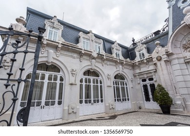 LISBON – July 5, 2018: Detail of the wide doors and windows on the mansard roof of the horse stables of the Vale Flor Palace in Alcantara, Lisbon, Portugal
