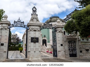 LISBON – July 5, 2018: Main gate of the 5 star hotel occupying the sumptuous neoclassical Vale Flor Palace built in early 20th century in Lisbon, Portugal