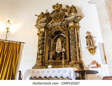 LISBON – July 5, 2018: View of the gilded side altar in the Chapel of Saint Amaro honouring the Virgin Mary, in Alcantara, Lisbon, Portugal