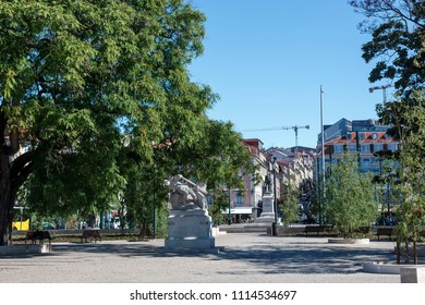 LISBON – June 15, 2018:  Small garden in front of the Cais do Sodre railway station where is located the beautiful sculpture called Man of the Helm