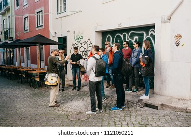 Lisbon, June 18, 2018: A guide from local residents tells tourists on a free tour of the sights of the city. Free tour from locals