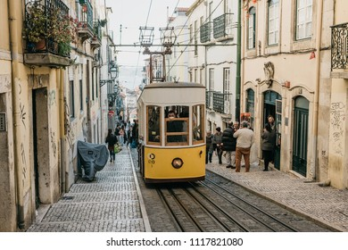 Lisbon, June 18, 2018: An old-fashioned yellow traditional tram ride on the city street