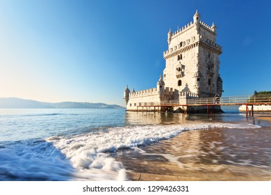 Lisbon. The magnificent Belem Tower in Manueline style on the background of the Tejo River in the sunset light (Torre de Belem)
