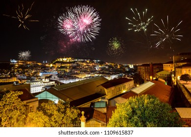 Lisbon at night with fireworks: View from Miradouro Bairro Alto to the castle Castelo de San Jorge and Alfama district, Portugal