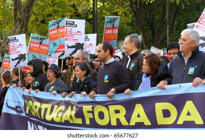LISBON - NOVEMBER 20: Members of the Portuguese Parliamentary Group of the Left Bloc participate in the protests against NATO, on the last day of NATO Summit in Lisbon. November 20, 2010.