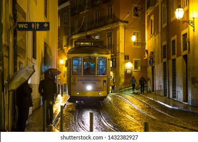Lisbon, October 30, 2018: City Famous Attraction Yellow Tramway Number 28 Running Through Old City at Night Time in Lisbon, Portugal