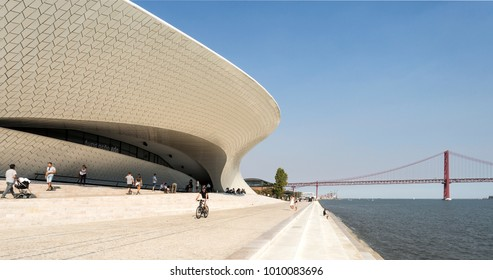 LISBON - October 7, 2017: People enjoying the riverside promenade in front of the manta ray shaped MAAT (Museum of Art, Architecture and Technology) in Lisbon, Portugal