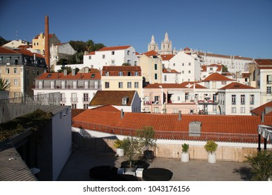 Lisbon - old and beautiful european city, capital of Portugal. Historical streets, buildings and roofs.