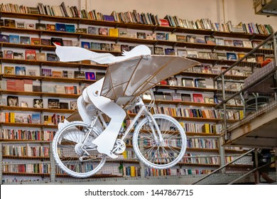 Lisbon, Portugal - 03/31/2019: Bicycle sculpture hanging in the air in LX Factory library