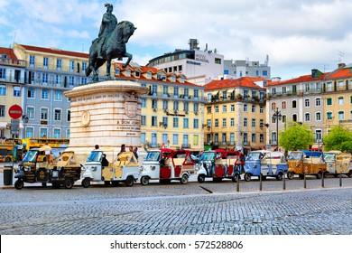 Lisbon, Portugal - 04 17 2015: many tuk-tuks waiting for tourists on John I of Portugal Place in Lisbon, Portugal