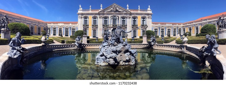 Lisbon. Portugal. 04.04.17. The National Palace of Queluz in Lisbon, Portugal. Neptune's Lake fountain in front of the Ceremonial Facade of the Corps de Logis designed by Oliveira.
