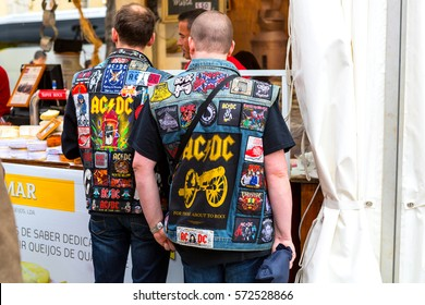 Lisbon, Portugal - 05 06 2016: Two fans of band AC/DC wearing jackets with many bands patches on the day of AC/DC show in Lisbon