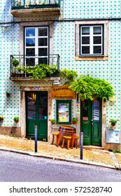 Lisbon, Portugal - 05.13.2016: facade and entrance to the little traditional portuguese restaurant located on sloping street in Lisbon, Portugal