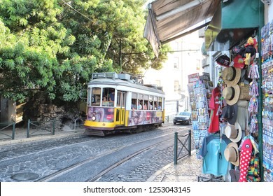 Lisbon, Portugal - 07.30.2016: The number 28 Lisbon tram connects Martim Moniz with Campo Ourique, and passes through the popular tourist districts of Graca, Alfama, Baixa and Estrela
