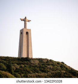 LISBON, PORTUGAL - 1 AUGUST 2018: The Sanctuary of Christ the King monument on the hills of Almada overlooking the city of Lisbon.