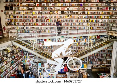 "LISBON, PORTUGAL - 12 of December 2018 - Woman tourist in Bookshop ""Livraria Ler Devagar"" in the LX factory"