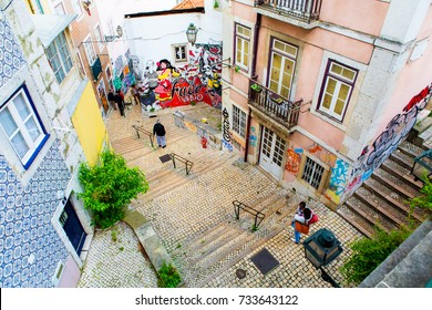 Lisbon, Portugal - 15 04 2015: People walking on a street stairs of Lisbon in Alfama district