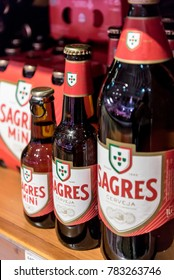 LISBON, PORTUGAL – 15 AUGUST 2017: Sagres Beer Bottles in different sizes sold in a market in the centre of Lisbon, Portugal