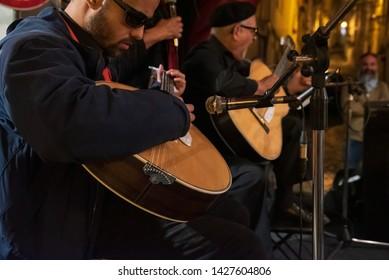 Lisbon, Portugal. 15 June 2019. Artists playing fado in a Portuguese fado guitar and singing fado