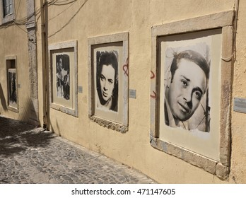 LISBON, PORTUGAL - 18 JULY, 2016: Street with pictures of famous Portuguese singers. At right  Francisco Martinho and Fernanda Maria.