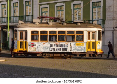 Lisbon, Portugal - 2 March 2020: Tourists riding the famous yellow Tram 28 in Baixa district