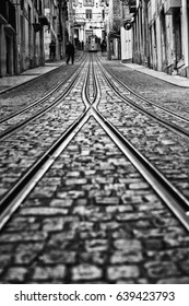 Lisbon, Portugal, 2015 04 18 - old tram - elevador da Bica standing on top of the rails, black and white