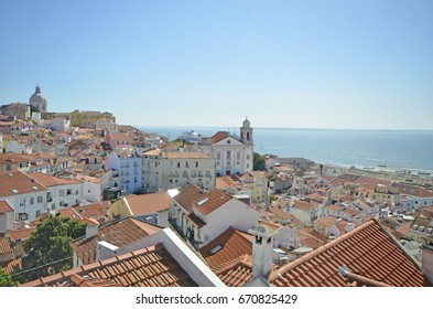 LISBON, PORTUGAL - 23rd of JUNE 2017: View over the colorful district of Alfama, Lisbon on a sunny summer morning. June 23rd, 2017. Lisbon, Portugal.