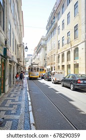 LISBON, PORTUGAL - 23rd of JUNE 2017: Traditional yellow tramway on the streets of Alfama district, Lisbon. June 23rd, 2017. Lisbon, Portugal.