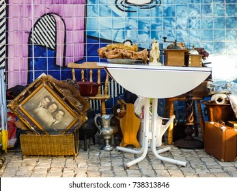 Lisbon, Portugal - 26 September 2017: Used furniture, a family portrait and other old objects for sale at Feira da Ladra, popular flea market in Lisbon