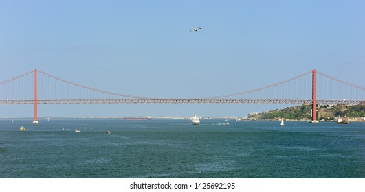 Lisbon, Portugal - 26th April 2019:Windstar Cruises Star Breeze lsailing under the April 25 Bridge