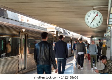 LISBON, PORTUGAL - 28 April 2019: People leaving train station in the late afternoon