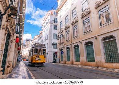 Lisbon, Portugal – 31 January, 2019 -   traditional yellow trams in Lisbon, Portugal. narrow street.