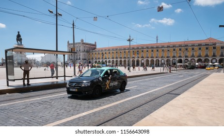 LISBON, PORTUGAL - 31 JULY 2018: A typical commercial taxi cab on the streets of Lisbon's central tourist location, the Comercio Square on a bright and sunny summers day.